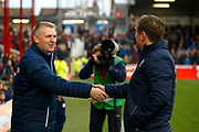 Brentford Manager / Head Coach Dean Smith and Bolton Wanderers manager Phil Parkinson  shake hands during the EFL Sky Bet Championship match between Brentford and Bolton Wanderers at Griffin Park, London, England on 13 January 2018. Photo by Andy Walter.