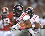 Ole Miss running back Brandon Bolden (34) is tackled by Alabama linebacker Dont'a Hightower (30) at Bryant-Denny Stadium in Tuscaloosa, Ala.  on Saturday, October 16, 2010. Alabama won 23-10.