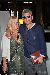 JAKE & IRENE PANAYIOTOU owner of the Browns club at a private view of a new collection of bronzes and original paintings by artist Jonathan Wylder and his muse Jennifer Wade held at the V&A Museum, London on 27th April 2011.