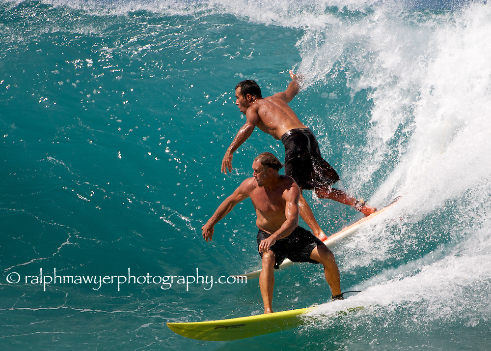 Amateur and past and current professional surfers working the outside break of Honolua Bay, Maui, Hawaii, February, 2011.