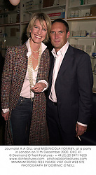 Journalist A A GILL and MISS NICOLA FORMBY, at a party in London on 11th December 2000.	OKC 41