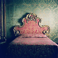 A period bed set in an old room.