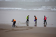 "Community volunteers battle rain and wind to draw the face of Poet & Soldier Wilfred Owen on the beach in Folkestone as part of Danny Boyle's 'Pages of the Sea""  Armistice Day event commemorating 100 years since the end of the First World War on remembrance day the 11th of November 2018. Sunny Sands beach, Folkestone, Kent, United Kingdom.  (photo by Andrew Aitchison / In pictures via Getty Images)"