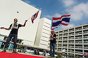 26 NOVEMBER 2013 - BANGKOK, THAILAND: Anti-government protestors wave Thai flags in the courtyard at the Ministry of Finance in Bangkok. Protestors opposed to the government of Thai Prime Minister Yingluck Shinawatra spread out through Bangkok this week. Protestors have taken over the Ministry of Finance, Ministry of Sports and Tourism, Ministry of the Interior and other smaller ministries. The protestors are demanding the Prime Minister resign, the Prime Minister said she will not step down. This is the worst political turmoil in Thailand since 2010 when 90 civilians were killed in an army crackdown against Red Shirt protestors. The Pheu Thai party, supported by the Red Shirts, won the 2011 election and now govern. The protestors demanding the Prime Minister step down are related to the Yellow Shirt protestors that closed airports in Thailand in 2008.     PHOTO BY JACK KURTZ