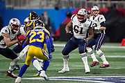New England Patriots offensive tackle Marcus Cannon (61) blocks during the NFL Super Bowl 53 football game against the Los Angeles Rams on Sunday, Feb. 3, 2019, in Atlanta. The Patriots defeated the Rams 13-3. (©Paul Anthony Spinelli)