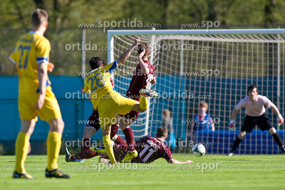 Alen Krcic of NK Triglav and Mato Simunovic of NK Domzale during football match between NK Triglav and NK Domzale in 23th Round of Slovenian First League PrvaLiga NZS 2012/13 on April 24, 2013 in Sports park Kranj, Slovenia. (Photo by Grega Valancic / Sportida)