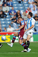 Picture by Graham Crowther/Focus Images Ltd. 07763140036.10/9/11 .Gary Roberts of Huddersfield pulls a cheaky foul on Adam McGurk of Tranmere during the Npower League 1 game at the Galpharm Stadium, Huddersfield.
