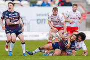 Leeds Rhinos full back Ashton Golding (1) is high tackled by Hull Kingston Rovers prop Mose Masoe (10)  during the Betfred Super League match between Hull Kingston Rovers and Leeds Rhinos at the Lightstream Stadium, Hull, United Kingdom on 29 April 2018. Picture by Simon Davies.