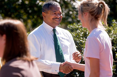 18356The Freshman Convocation 9/03/2007...Dr. McDavis greets freshman at the Alumni Gateway
