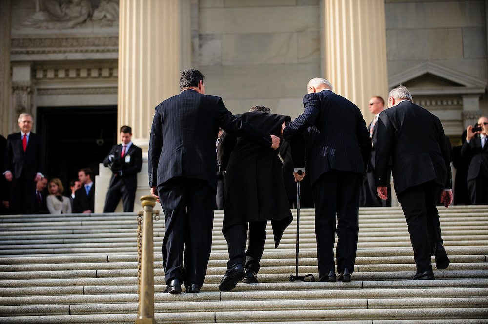Vice President Joe Biden and Senator Joe Manchin (D-WV) escort Senator Mark Kirk (R-IL) as he makes his return to Congress at the U.S. Capitol in Washington, District of Columbia, U.S., on Thursday, Jan. 3, 2013. Kirk, 53, climbed the steps at 10:30 a.m. accompanied by Vice President Joe Biden and Senator Dick Durbin (D-IL). The 133th Congress begins Thursday with the swearing in of newly elected Members of Congress and the election of the Speaker of the House of Representatives. Photographer: Pete Marovich/Bloomberg
