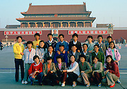 Chinese students posing for a group photograph in front of the Gate of Heavenly Peace entrance to the Forbidden City in Beijing, China