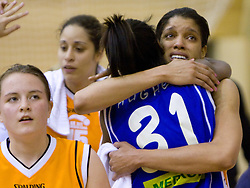 Nikya Hughes of Celje with Khaili Sanders of Kranjska Gora  at finals match of Slovenian 1st Women league between KK Hit Kranjska Gora and ZKK Merkur Celje, on May 14, 2009, in Arena Vitranc, Kranjska Gora, Slovenia. Merkur Celje won the third time and became Slovenian National Champion. (Photo by Vid Ponikvar / Sportida)