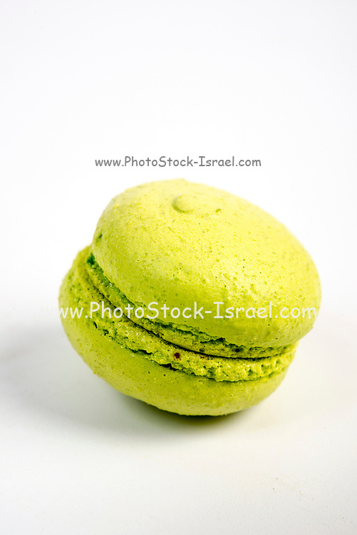 Green macaroon biscuit isolated on white.