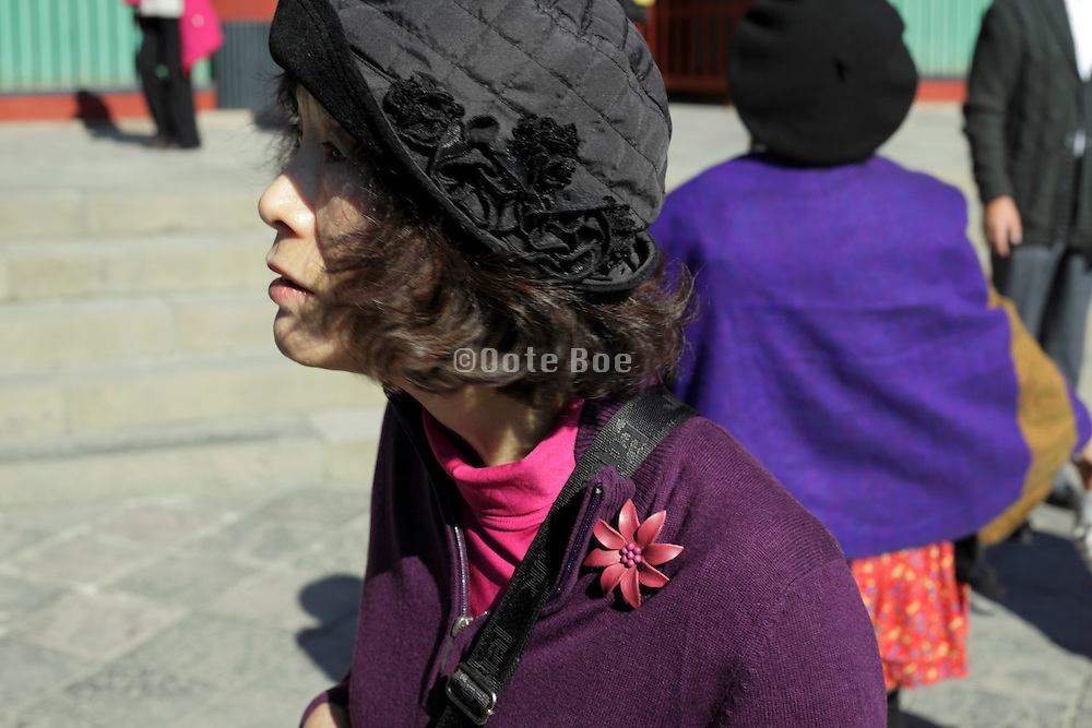 side view of an fashionable dressed senior Japanese woman