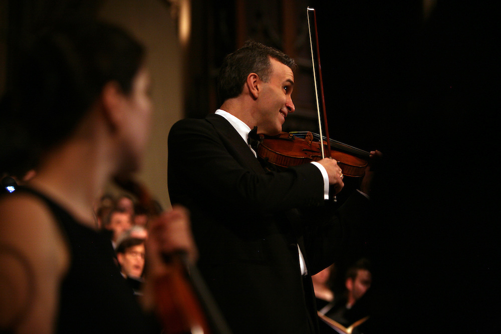 Violinist Gil Shaham performs during Remember to Love: Let Us Love One Another With A Sincere Heart, an observation of the 10th Anniversary of September 11 at Trinity Church in Manhattan, NY on September 09, 2011. The six choirs performing include NYC Master Chorale, Trinity Choir, Young People's Chorus of New York City, The Washington Chorus, The Bach Choir of Bethlehem and The Copley Singers.