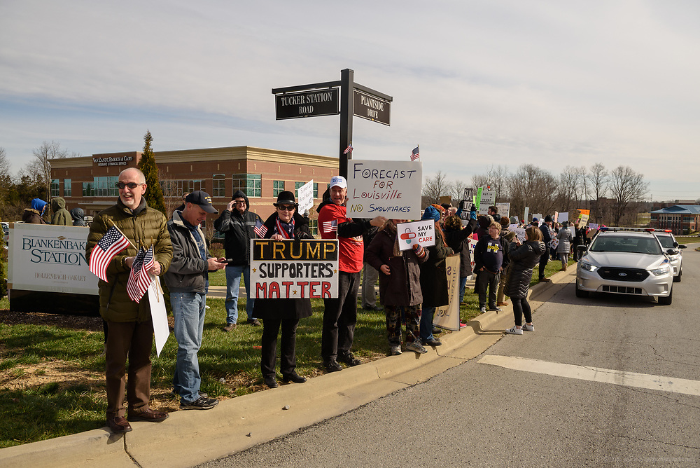 Trump supporters gathered at the corner of Tucker Station Road and Plantside Drive at the head of the line to greet the Vice President. Groups protest The Republican Party's proposed changes to the Affordable Care Act during a visit by Vice President Mike Pence with Kentucky Governor Matt Bevin and business leaders Saturday, March 11, 2017 at Trane Parts and Distribution Center, 12850 Plantside Drive, Louisville, Ky. (Photo by Brian Bohannon)