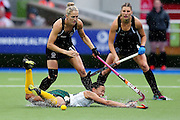 Stacey Michelsen of New Zealand competes against Lenise Marais of South Africa during the bronze medal match between New Zealand and South Africa. Glasgow 2014 Commonwealth Games. Hockey, Bronze Medal Match, Black Sticks Women v South Africa, Glasgow Green Hockey Centre, Glasgow, Scotland. Saturday 2 August 2014. Photo: Anthony Au-Yeung / photosport.co.nz