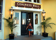 A tourist exits the beachfront entrance to the newly renovated Congress Hall is shown, Sunday, August 11, 2002, in Cape May, New Jersey. The hotel recently underwent a two-year eighteen-million-dollar renovation, and re-opened in June 2002. (Photo by William Thomas Cain/photodx.com)