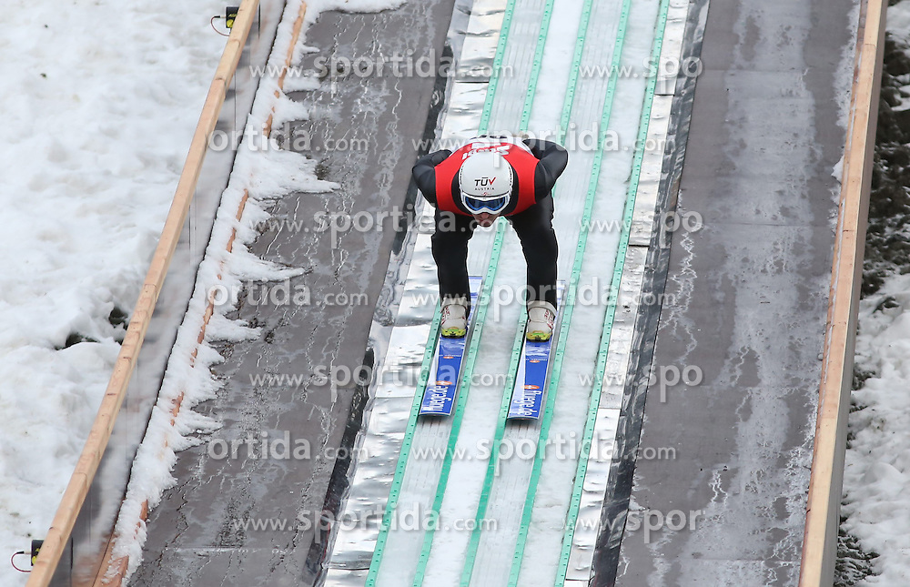 28.12.2013, Nordische Arena, Ramsau, AUT, OeSV Training, Nordische Kombination, im Bild Lukas Klapfer (AUT) waehrend des Skisprung-Anlauf-Trainings // Lukas Klapfer of Austria during a Trainingsession of Austrian Nordic Combined Team at the Nordic Arena in Ramsau, Austria on 2013/12/28, EXPA Pictures © 2013, PhotoCredit: EXPA/ Martin Huber