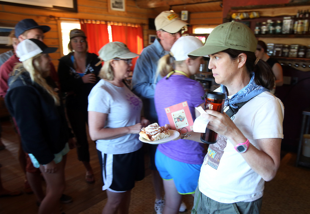 Libby Sunderman of Salt Lake City, UT carries a cinnamon roll back to her table on Sunday morning July 14, 2013 at a packed Stanley Baking Company & Cafe in the central Idaho town of Stanley at the base of the Sawtooth Mountains.