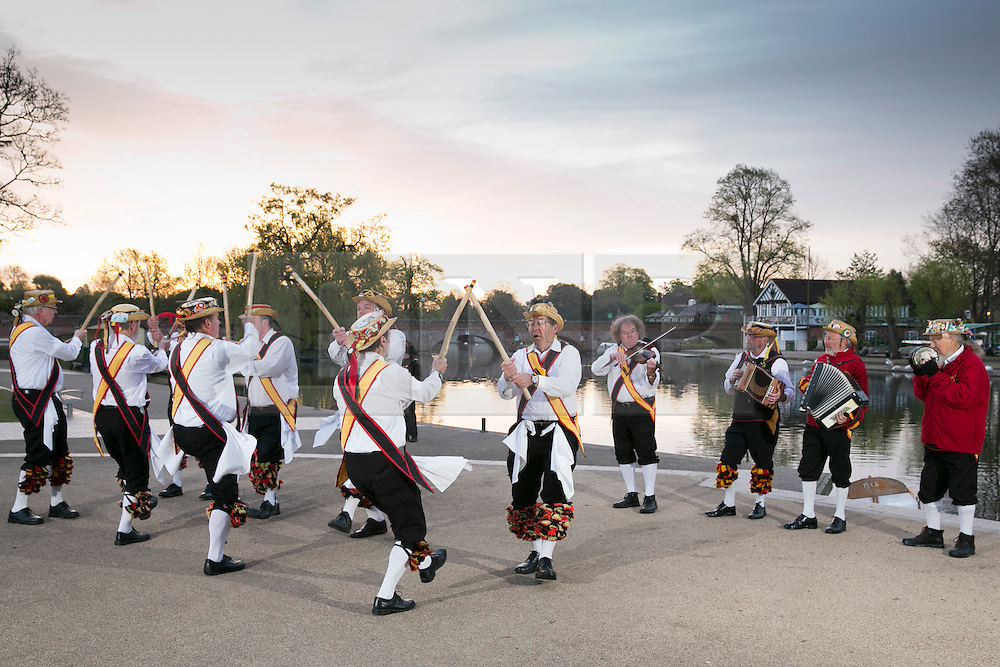 "© Licensed to London News Pictures. 01/05/2015. Stratford upon Avon, Warwickshire, UK. The Shakespeare Morris Men ""Dance in the Dawn"" on the banks of the River Avon near the centre of Stratford upon Avon on the first day of May. Photo credit : Dave Warren/LNP"