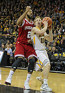 December 31 2012: Iowa Hawkeyes guard Mike Gesell (10) puts up a shot as Indiana Hoosiers forward Christian Watford (2) defends during the first half of the NCAA basketball game between the Indiana Hoosiers and the Iowa Hawkeyes at Carver-Hawkeye Arena in Iowa City, Iowa on Monday December 31, 2012. Indiana defeated Iowa 69-65.