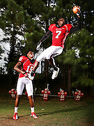 Josh Imatorbhebhe (7) and his older brother Daniel (15) stand for a portrait at North Gwinnett High School in Sugar Hill on Thursday. The Imatorbhebhe brothers do everything together, on and off the field. This year, each is on target for impressive individual seasons for the Bulldogs. (Staff Photo: David Welker)