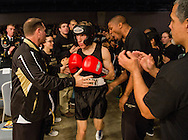 Army Boxer Jordan Isham is cheered as he walks to the ring for his fight during the Army-Navy Boxing Classic at the Pennsylvania Convention Center on Friday night before the long-time rivalry football game. The bouts featured boxers from both academy's boxing clubs. Army was the overall winner.