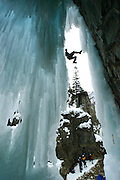 World famous climber and guide Fabrizio Zangrilli, (top) breaks off shards of ice from a curtain in the Ouray Ice Park during a clinic on modern mixed ice climbing near Ouray, Colorado March 5, 2005. The Uncompahgre Gorge near Oury is the site for the world's largest man-made ice-climbing park with over 180 ice routes.