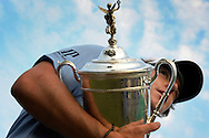 Rory McIlroy cradles the U.S. Open Championship Trophy after his 2011 victory at Congressional.