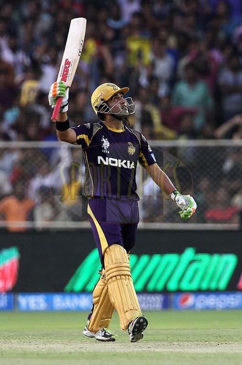 Gautam Gambhir captain of the Kolkata Knight Riders raises his bat after scoring a fifty during match 25 of the Pepsi Indian Premier League Season 2014 between the Rajasthan Royals and the Kolkata Knight Riders held at the Sardar Patel Stadium, Ahmedabad, India on the 5th May  2014<br /> <br /> Photo by Vipin Pawar / IPL / SPORTZPICS      <br /> <br /> <br /> <br /> Image use subject to terms and conditions which can be found here:  http://sportzpics.photoshelter.com/gallery/Pepsi-IPL-Image-terms-and-conditions/G00004VW1IVJ.gB0/C0000TScjhBM6ikg
