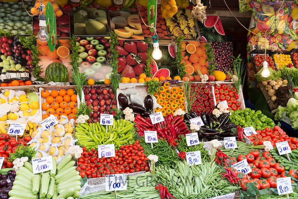Fresh fruit vegetables tomato pimento oranges courgettes beans Turkish lira prices at food market Kadikoy Asian Istanbul Turkey