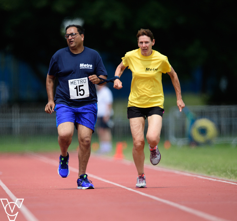 Metro Blind Sport's 2017 Athletics Open held at Mile End Stadium.  100m.  Atif Umer with guide runner<br /> <br /> Picture: Chris Vaughan Photography for Metro Blind Sport<br /> Date: June 17, 2017