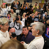Osceola County Commisioner Cheryl Grieb, right, and partner Patti Daugherty, smile as they give their vows during Osceola County Florida's first gay marriage which started just after midnight on January 6, 2015 at the Osceola County courthouse in Kissimmee, Florida.  (AP Photo/Alex Menendez)