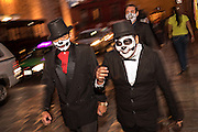 Men dressed as skeletons walk through the streets during the Day of the Dead festival October 28, 2016 in San Miguel de Allende, Guanajuato, Mexico. The week-long celebration is a time when Mexicans welcome the dead back to earth for a visit and celebrate life.