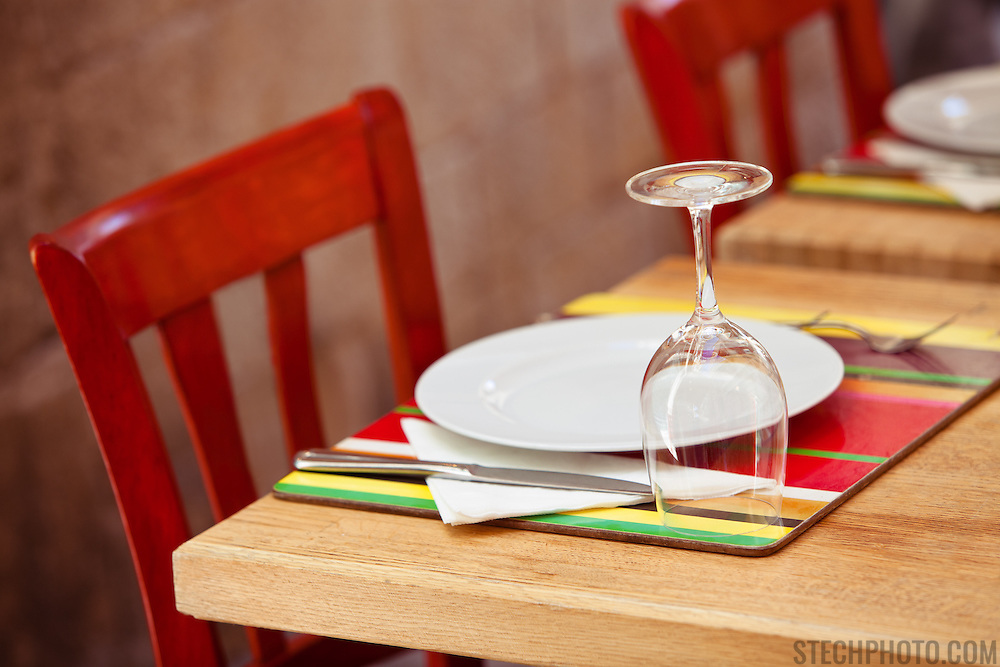 A colorful place setting at a street restaurant in Croatia.