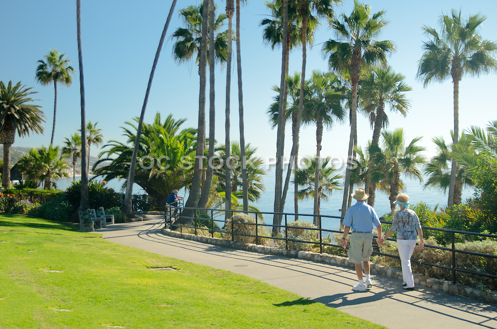 Married Mature Couple Walking at Strand Vista Park in Dana Point