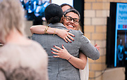 Ali Muldrow and Ananda Mirilli embrace after accepting the duties of the Madison Metropolitan School board positions during the MMSD swearing-in ceremony at Cesar Chávez Elementary School in Madison, WI on Monday, April 29, 2019.