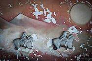 A relief of a Caucasian horseman at the Bursa Caucasus House. Bursa, 2009.