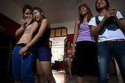 YANGON, MYANMAR, MARCH 2012: Rehearsal break at Nicole May's house, central Yangon.<br /> Burma is a country in Transition. And if that hasn't been made clear enough by the political debates and the recent by-elections, meet the Me N Ma Girls, the first girlband in the country.<br /> The timing couldn't be better. After the April 1st elections in 2012 an always increasing number of investors from all over the world has been visiting Myanmar. After decades of military regime and isolation, the strings of censorship have started loosening up. The government censors in fact for years have banned songs and articles, deleting anything that was seen as &quot;to provocative&quot; such as leather outfits and colored wigs.<br /> Describing themselves as Myanmar's first all-girl group, under the management of the Australian dancer and choreographer Nicole May, these five women - coming from either Buddhist or Catholic background and formerly known as Tiger Girls - not only have been challenging censorship laws but they're as well trying to win hearts in a society that in many ways remains man-dominated and socially conservative.<br /> In a country that has been locked up for years, the Me N Ma Girls, embracing western pop culture with skimpy outfits and catchy songs, show with every performance the will of the Burmese youth to come out of a decades-long isolation.<br /> Five girls leading a new form of rebellion: the kind that questions roles and cultural norms.