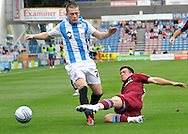 Picture by Graham Crowther/Focus Images Ltd. 07763140036.10/9/11 .Donal McDermottof Huddersfield is tackled by Dave Buchanan of Tranmere during the Npower League 1 game at the Galpharm Stadium, Huddersfield.