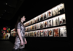 A gallery assistant looks at a range of magazines during the preview into the 'Christian Dior: Designer of Dreams' at the Victoria and Albert Museum, London. Picture dated: Wednesday January 30, 2019. Photo credit should read: Isabel Infantes / EMPICS Entertainment.