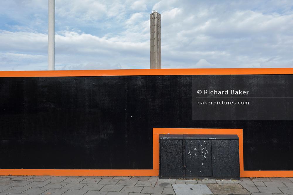 New housing development hoarding landscape in Peckham, on 16th November 2017, in London, England.