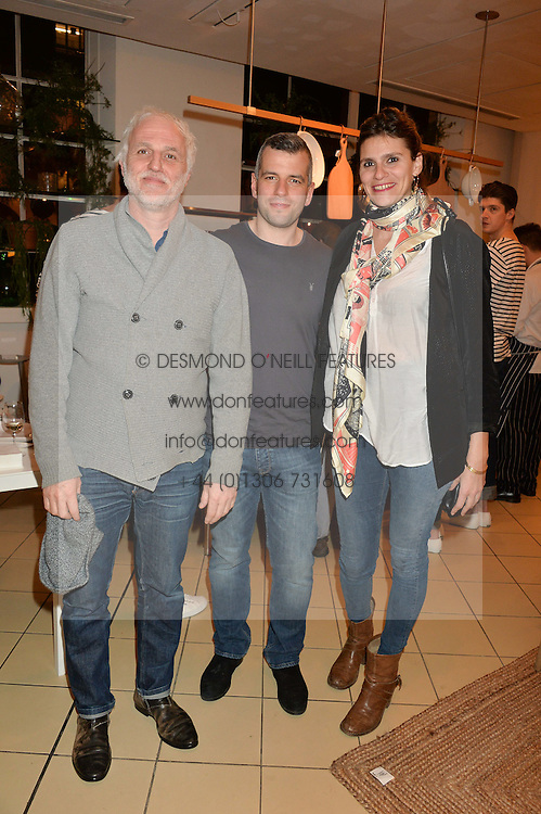 Left to right, MOURAD MAZOUZ, JACOB KENEDY and CAROLINE KARIM KASSAR at a party to celebrate the launch of Conran Italia at The Conran Shop, Michelin House, 81 Fulham Road, London on 19th March 2015.