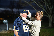 """Highland, Maryland - December 03, 2018: Greg Horne with his wife Pam Horne at their home in Highland, Md Monday Dec. 3, 2018. <br /> <br /> <br /> Unbeknownst to him, fifty-four-years-ago, a bet was placed on Naval Academy cadet Greg Horne's benefit, while he was recovering from an injury. Navy lost to Army and he owed Ed Dewey, a West Point cadet, a USNA parka. <br /> <br /> Ed even sent a follow-up letter asking Greg to """"pay-up."""" -- but Greg was at sea, and his mail was forwarded to his mother's home. He found the then 52-year-old letter, while he and his siblings cleaned out their late mother's house in 2016. It took some time, but Greg tracked down Ed. <br /> <br /> The parkas are not longer made, so to make good on his bet, he sent Ed a commemorative USNA blanket, similar to one he owns. <br /> <br /> CREDIT: Matt Roth for The New York Times<br /> Assignment ID: 30228001A"""