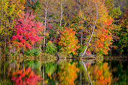 Beautiful fall colors reflecting in Centennial Lake in Maryland.
