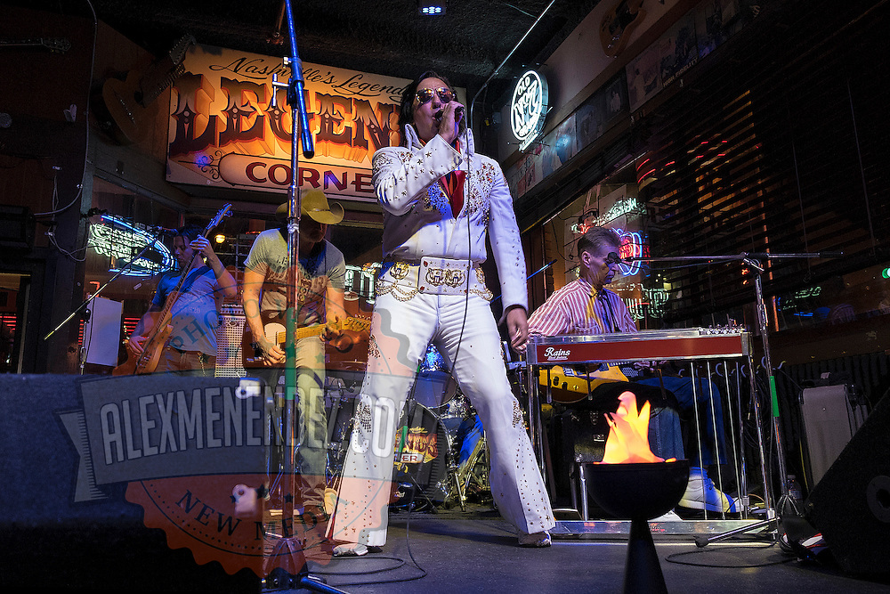An Elvis impersonator performs in a bar on Music Row in downtown Nashville, Tennessee on Friday, November 13, 2015. (Alex Menendez via AP)