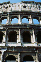 Arches on exterior of the Coliseum against blue sky Rome Italy