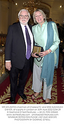MR KEN BATES chairman of Chelsea FC and MISS SUSANNAH DWYER, at a party in London on 30th April 2002.OZM 29