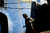 A young woman on the back streets of Chaouen, Morocco.